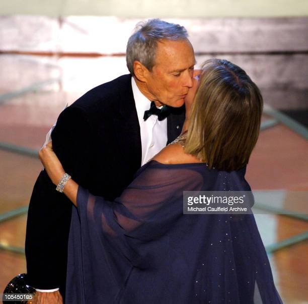 Clint Eastwood winner Best Picture for 'Million Dollar Baby' hugs Barbra Streisand presenter
