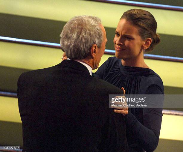 Clint Eastwood winner Best Picture for 'Million Dollar Baby' hugs Hilary Swank winner Best Actress in a Leading Role for 'Million Dollar Baby'