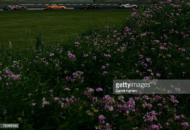 Clint Field in the Intersport Racing Creation CA06H leads Marino Franchitti in the Andretti Green Racing Acura ARX O1 Saascha Maassen in the Penske...