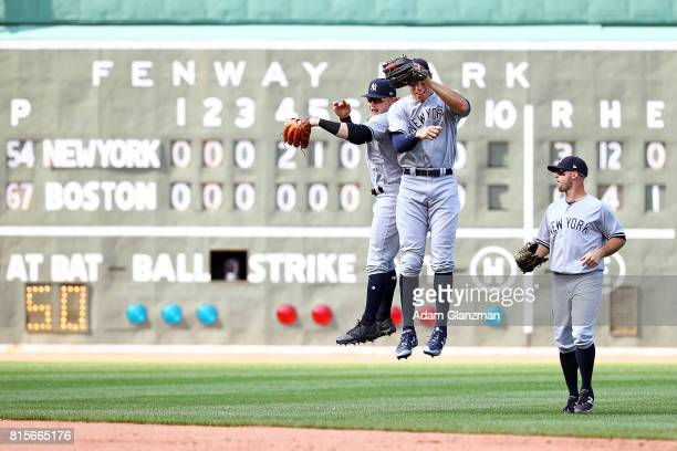 Clint Frazier Aaron Judge and Brett Gardner of the New York Yankees react after the victory in game one of a doubleheader against the Boston Red Sox...