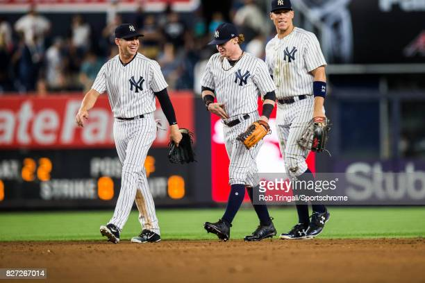 Clint Frazier Jacoby Ellsbury and Aaron Judge of the New York Yankees celebrate a win against the Detroit Tigers at Yankee Stadium on July 31 2017 in...