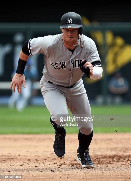 Clint Frazier of the New York Yankees breaks for third base during the 1st inning of the game against the Kansas City Royals at Kauffman Stadium on...