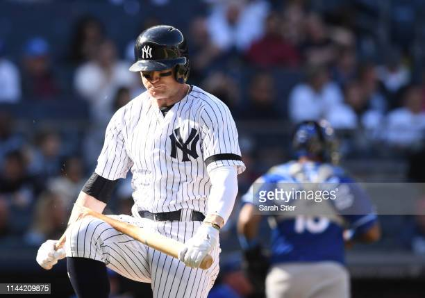 Clint Frazier of the New York Yankees breaks his bat after striking out during the ninth inning of the game against the Kansas City Royals at Yankee...