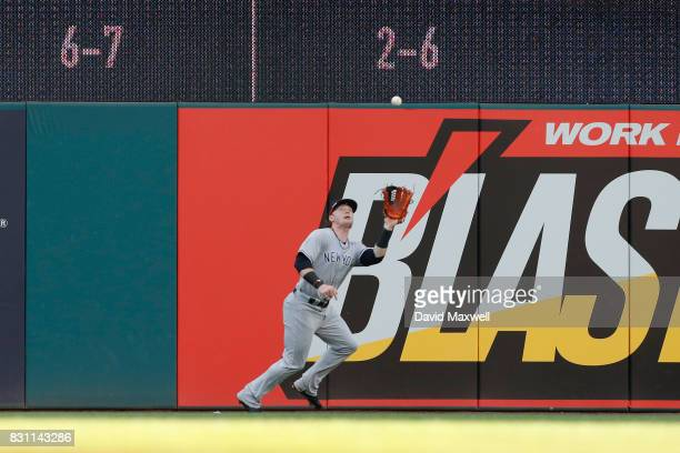 Clint Frazier of the New York Yankees catches a fly ball hit by Brandon Guyer of the Cleveland Indians at Progressive Field on August 4 2017 in...