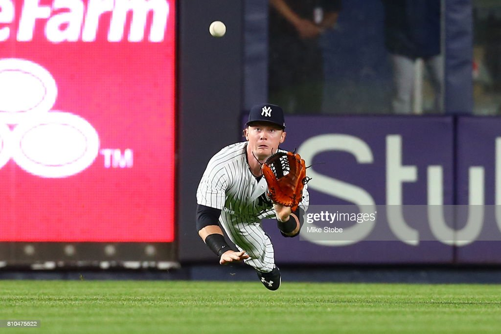 Clint Frazier #30 of the New York Yankees catches a line drive off th ebat Keon Broxton #23 of the Milwaukee Brewers in the fifth inning at Yankee Stadium on July 7, 2017 in the Bronx borough of New York City.
