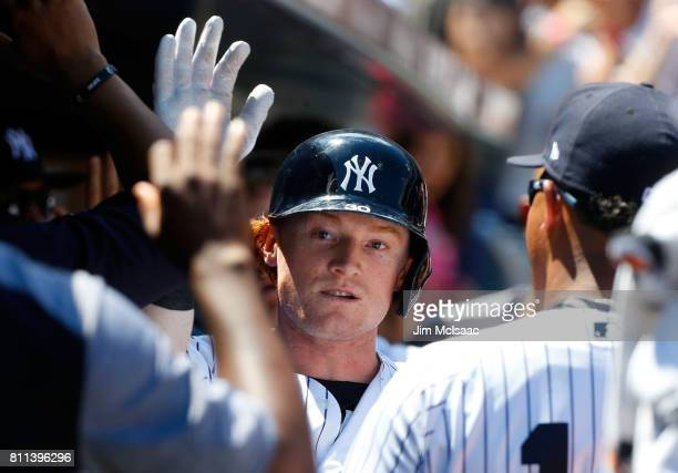 Clint Frazier of the New York Yankees celebrates his fourth inning two run home run against the Milwaukee Brewers with his teammates in the dugout at...