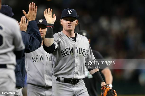 Clint Frazier of the New York Yankees gets congratulations after the game against the Seattle Mariners at Safeco Field on July 21 2017 in Seattle...