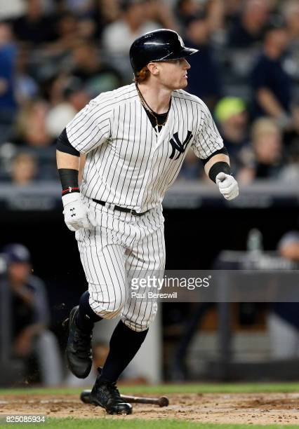 Clint Frazier of the New York Yankees heads to first base watching his home run clear the wall in the 5th inning of an MLB baseball game against the...