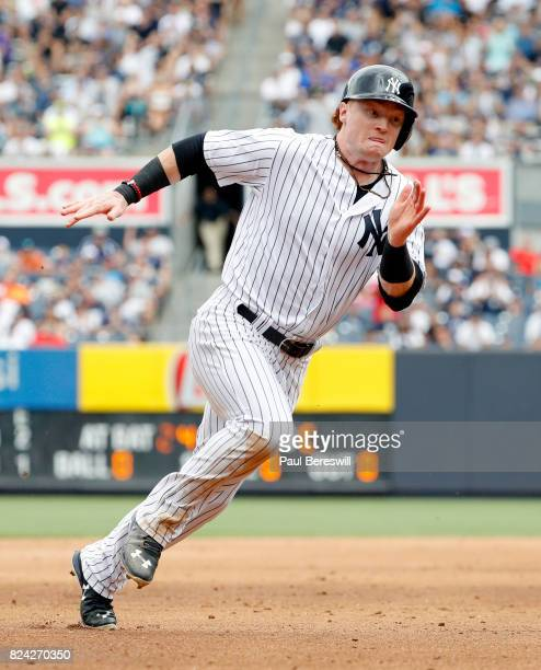 Clint Frazier of the New York Yankees heads to third base as he runs home to score on a double by Gary Sanchez in an interleague MLB baseball game...