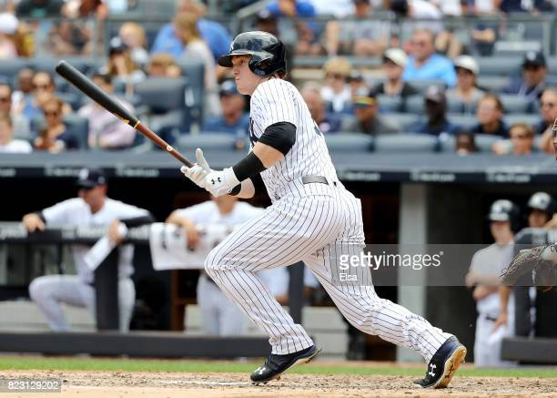 Clint Frazier of the New York Yankees hits an RBI single in the fifth inning against the Cincinnati Reds on July 26 2017 at Yankee Stadium in the...