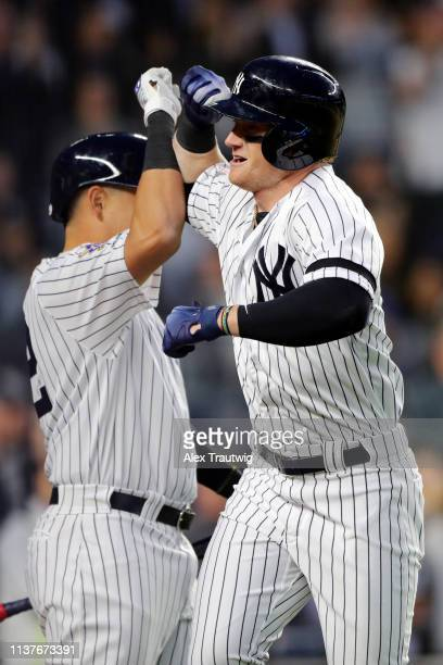 Clint Frazier of the New York Yankees is greeted by teammate Gio Urshela after hitting a solo home run in the fourth inning during the game between...