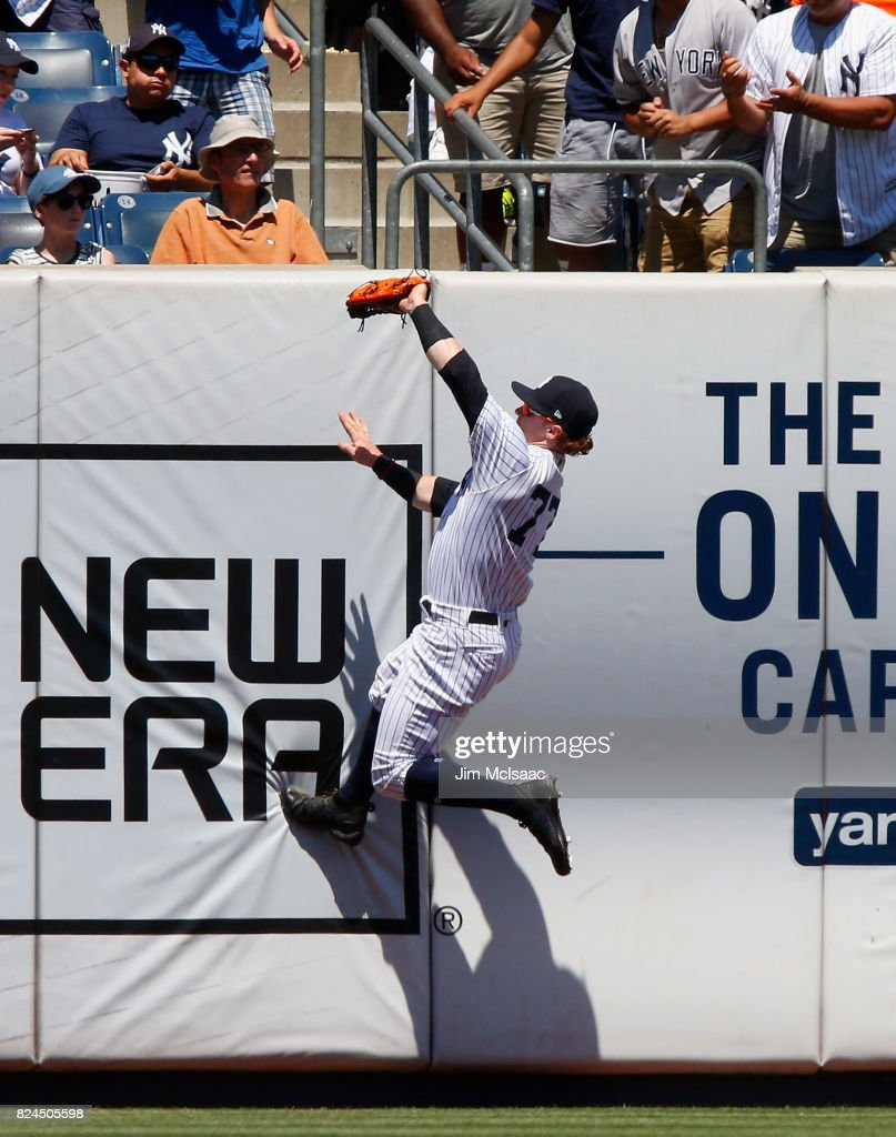 Clint Frazier #77 of the New York Yankees makes a catch at the wall on a ball hit by Adeiny Hechavarria of the Tampa Bay Rays for the final out of the second inning at Yankee Stadium on July 30, 2017 in the Bronx borough of New York City.