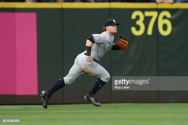 Clint Frazier of the New York Yankees plays left field during the game against the Seattle Mariners at Safeco Field on July 21 2017 in Seattle...