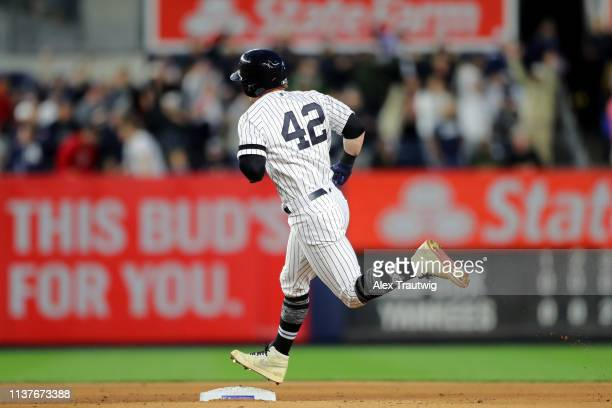 Clint Frazier of the New York Yankees rounds the bases after hitting a solo home run in the fourth inning during the game between the Boston Red Sox...