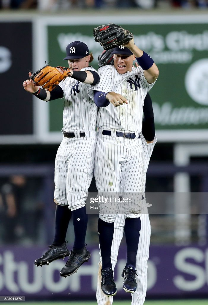 Clint Frazier #77,Jacoby Ellsbury #22 and Aaron Judge #99 of the New York Yankees celebrate the win over the Detroit Tigers on July 31, 2017 at Yankee Stadium in the Bronx borough of New York City.