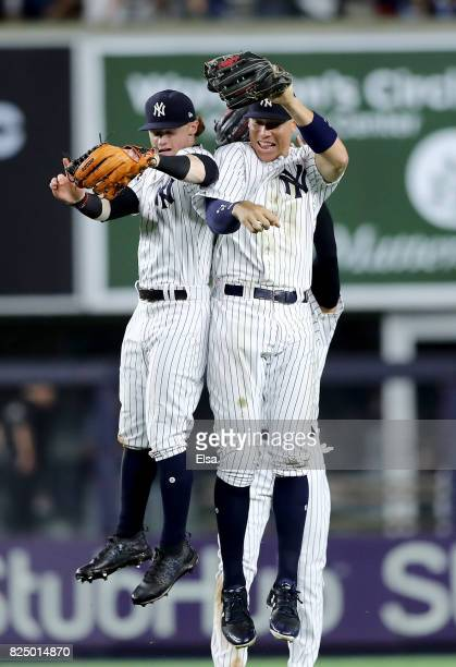 Clint FrazierJacoby Ellsbury and Aaron Judge of the New York Yankees celebrate the win over the Detroit Tigers on July 31 2017 at Yankee Stadium in...