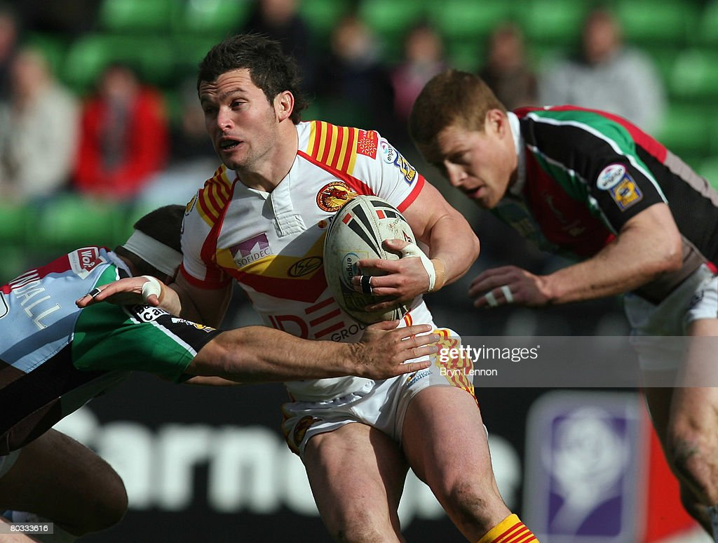 Clint Greenshields of the Catalan Dragons is tackled by Chad Randall during the engage Super League match between Harlequins RL and Catalan Dragons at The Stoop on March 21, 2008 in Twickenham, England.