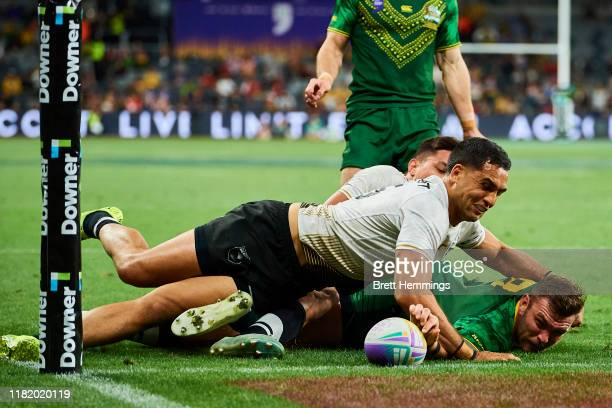 Clint Gutherson of Australia scores a try during the Final Rugby League World Cup 9s match between Australia and New Zealand at Bankwest Stadium on...
