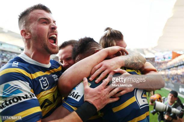 Clint Gutherson of the Eels celebrates a try by Maika Sivo of the Eels during the NRL Elimination Final match between the Parramatta Eels and the...