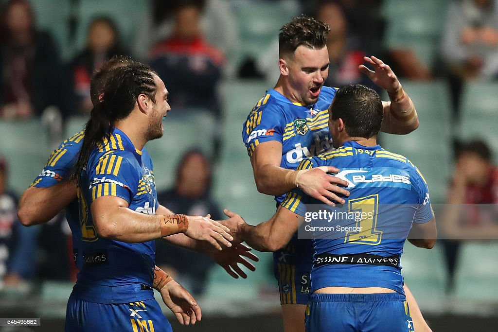 Clint Gutherson of the Eels congratulates team mate Michael Gordon of the Eels after scoring a try during the round 18 NRL match between the Parramatta Eels and the Sydney Roosters at Pirtek Stadium on July 8, 2016 in Sydney, Australia.