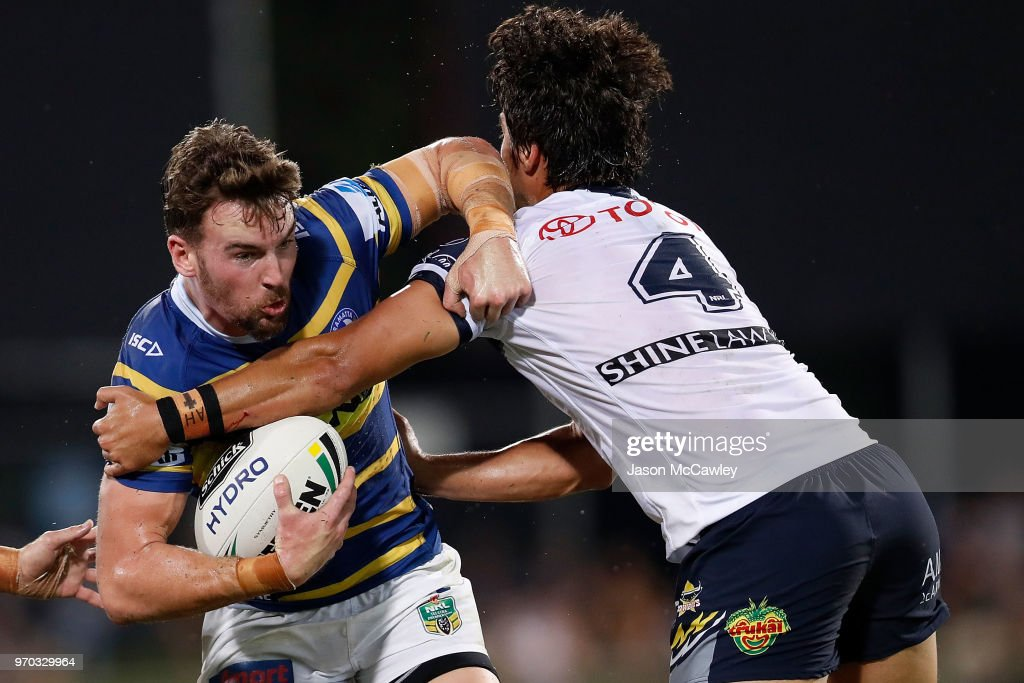 Clint Gutherson of the Eels is tackled by Enari Tuala of the Cowboys during the round 14 NRL match between the Parramatta Eels and the North Queensland Cowboys at TIO Stadium on June 9, 2018 in Darwin, Australia.