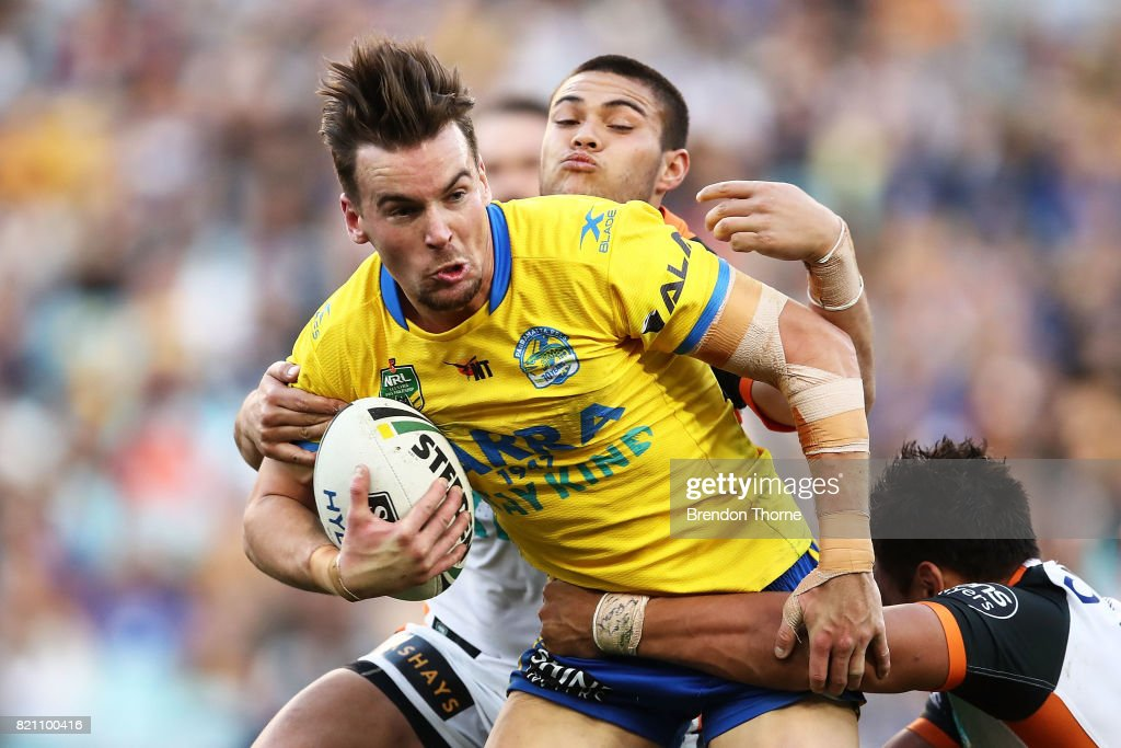 Clint Gutherson of the Eels is tackled by the Tigers defence during the round 20 NRL match between the Wests Tigers and the Parramatta Eels at ANZ Stadium on July 23, 2017 in Sydney, Australia.