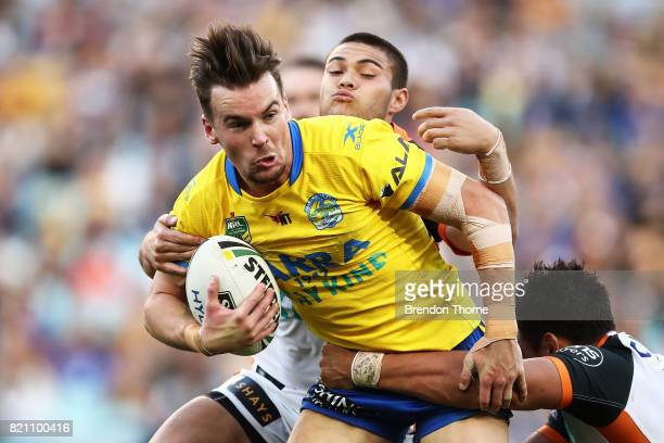 Clint Gutherson of the Eels is tackled by the Tigers defence during the round 20 NRL match between the Wests Tigers and the Parramatta Eels at ANZ...