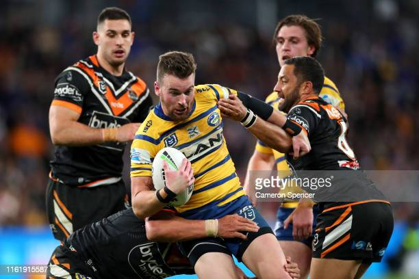 Clint Gutherson of the Eels is tackled during the round 17 NRL match between the Wests Tigers and the Parramatta Eels at Bankwest Stadium on July 14,...