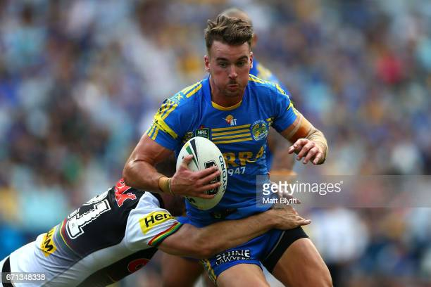 Clint Gutherson of the Eels is tackled during the round eight NRL match between the Parramatta Eels and the Penrith Panthers at ANZ Stadium on April...