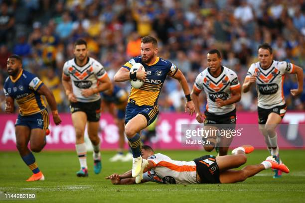 Clint Gutherson of the Eels makes a break during the round 6 NRL match between the Parramatta Eels and Wests Tigers at Bankwest Stadium on April 22...