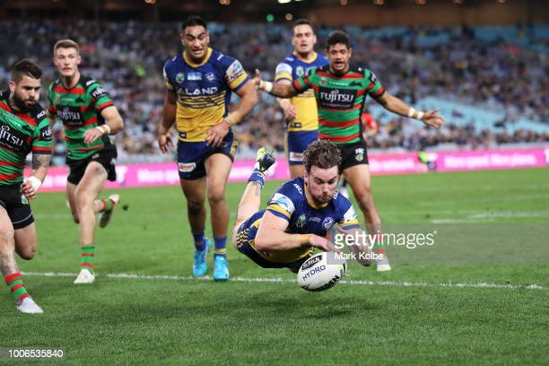 Clint Gutherson of the Eels scores a try during the round 20 NRL match between the South Sydney Rabbitohs and the Parramatta Eels at ANZ Stadium on...