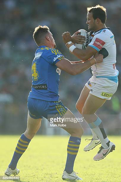 Clint Gutherson of the Eels tackles Tyrone Roberts of the Titans during the round 14 NRL match between the Parramatta Eels and the Gold Coast Titans...