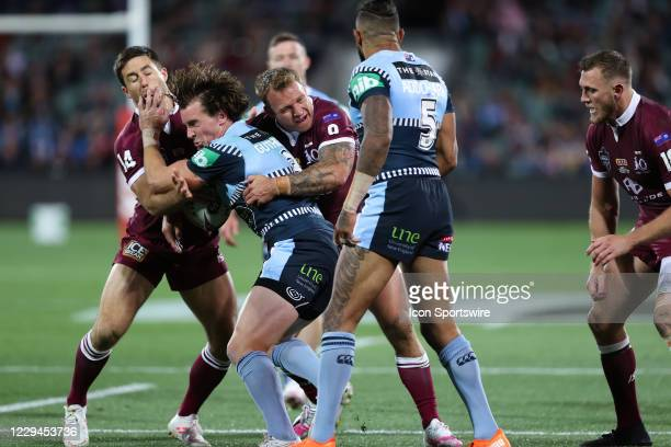 Clint Gutherson of the NSW Blues is tackled hard during game one of the 2020 State of Origin series between the Queensland Maroons and New South...
