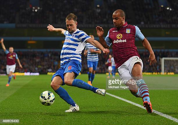 Clint Hill of QPR clears the ball from Gabriel Agbonlahor of Aston Villa during the Barclays Premier League match between Aston Villa and Queens Park...