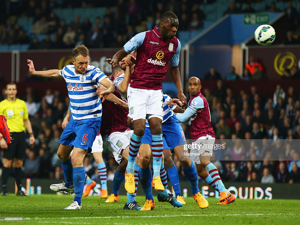 Clint Hill of QPR (6) scores their second goal with a header during the Barclays Premier League match between Aston Villa and Queens Park Rangers at Villa Park on April 7, 2015 in Birmingham, England.
