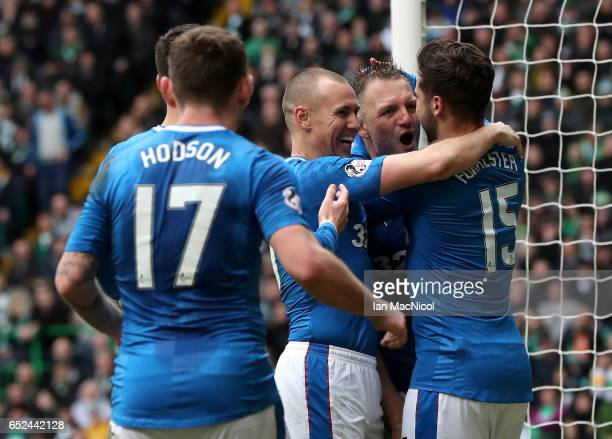Clint Hill of Rangers celebrates scoring his sides first goal with his Rangers team mates during the Ladbrokes Scottish Premiership match between...