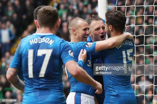 Clint Hill of Rangers is congratulated after he scores during the Ladbrokes Scottish Premiership match between Celtic and Rangers at Celtic Park on...