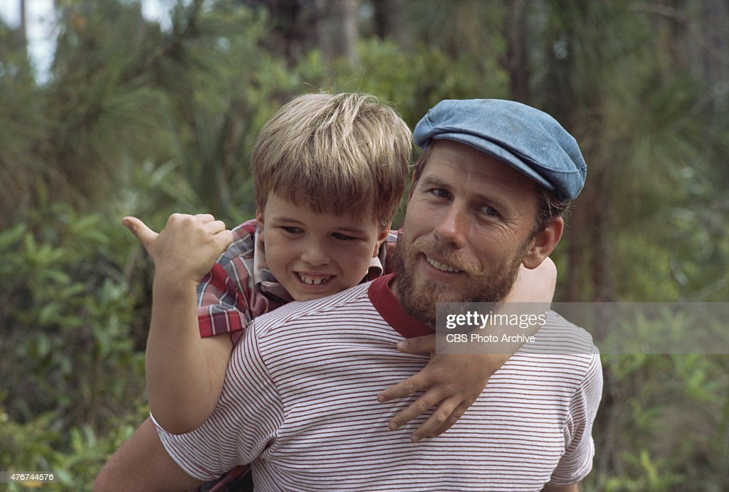Clint Howard as Mark Wedloe and Rance Howard as Henry Boomhauer in GENTLE BEN. Image dated 1968.