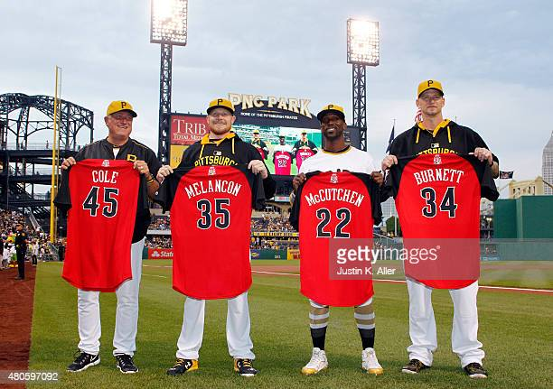 Clint Hurdle of the Pittsburgh Pirates accepts the All Star jersey of Gerrit Cole alongside Mark Melancon Andrew McCutchen and AJ Burnett before the...
