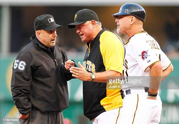 Clint Hurdle of the Pittsburgh Pirates argues a call at first base with Eric Cooper during the game on July 29 2013 at PNC Park in Pittsburgh...