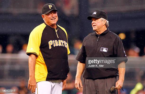 Clint Hurdle of the Pittsburgh Pirates argues a call with second base umpire Dana DeMuth in the first inning during the game on September 12 2013 at...