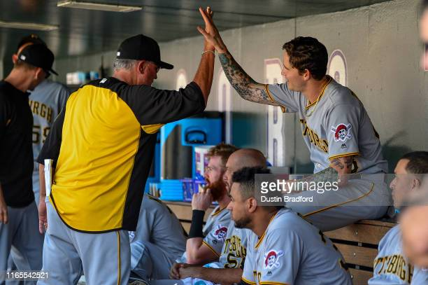 Clint Hurdle of the Pittsburgh Pirates is the first to congratulate Steven Brault after Brault hit a seventh inning solo home run for the first of...