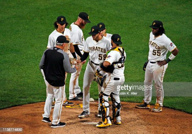 Clint Hurdle of the Pittsburgh Pirates removes Joe Musgrove of the Pittsburgh Pirates from the game in the seventh inning against the Arizona...