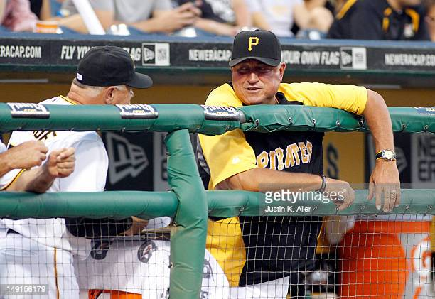 Clint Hurdle of the Pittsburgh Pirates talks with pitching coach Ray Searage during the game against the Chicago Cubs on July 23 2012 at PNC Park in...