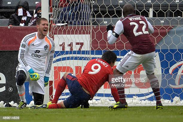 Clint Irwin of Colorado Rapids and Marvell Wynne react to a 10 goal by Erick Torres of Chivas USA during the second half Chivas USA defeated the...