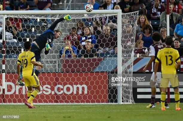 Clint Irwin of the Colorado Rapids punches the ball away as Jairo Arrieta of the Columbus Crew Ethan Finlay of the Columbus Crew and Chris Klute of...
