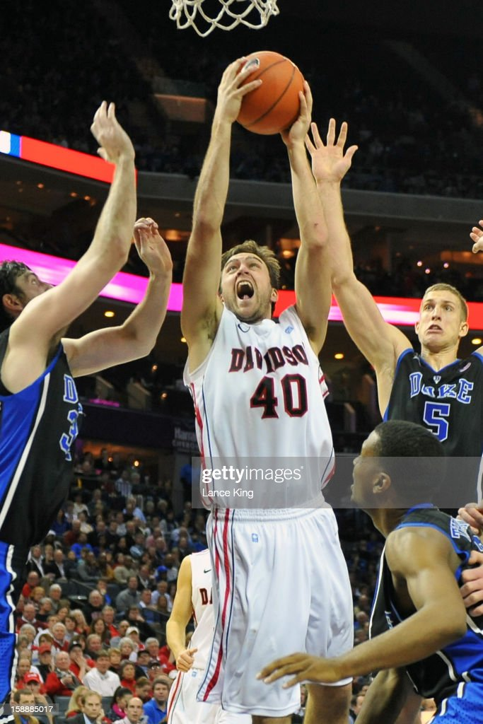 Clint Mann #40 of the Davidson Wildcats goes to the hoop against Ryan Kelly #34 and Mason Plumlee #5 of the Duke Blue Devils at Time Warner Cable Arena on January 2, 2013 in Charlotte, North Carolina. Duke defeated Davidson 67-50.