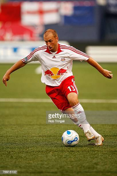 Clint Mathis of the New York Red Bulls handles the ball against the New England Revolution on July 14 2007 at Giants Stadium in East Rutherford New...