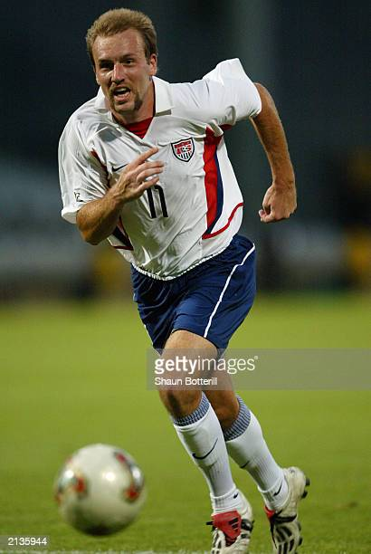 Clint Mathis of USA chases the ball during the Confederations Cup Group B match between USA and Cameroon on June 23, 2003 at the Stade Gerland in...