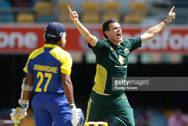 Clint McKay of Australia takes the wicket of Mahela Jayawardene of Sri Lanka during the Commonwealth Bank Series match between Australia and Sri...